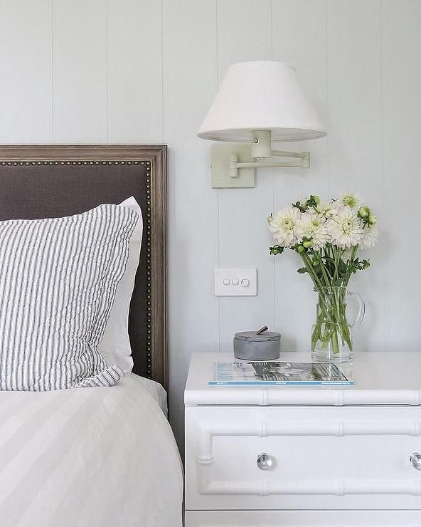 A White Vertical Shiplap Wall Is Positioned Behind A Wood And