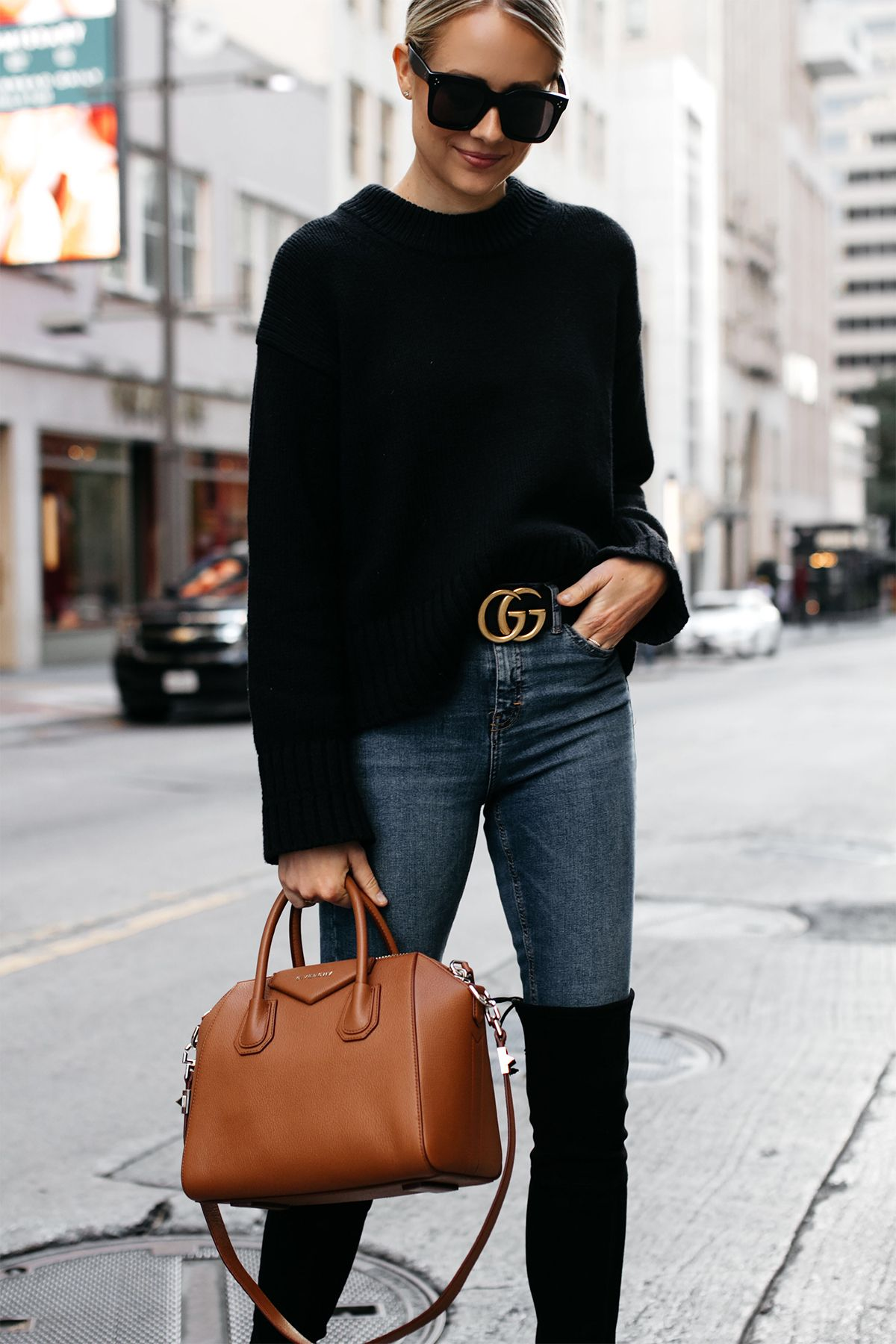 0d170b10e24 Blonde Woman Wearing Everlane Black Oversized Sweater Denim Skinny Jeans  Gucci Marmont Belt Stuart Weitzman Black Over the Knee Boots Givenchy  Antigona ...