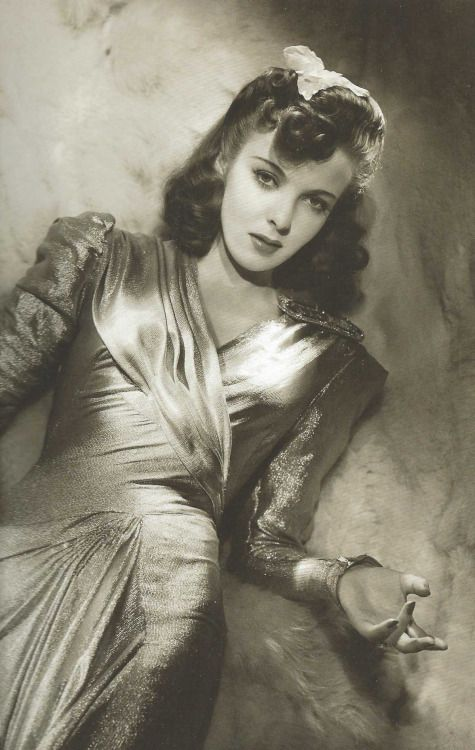 They Drive by Night (1940) - Ida Lupino as Lana Carlsen wearing a lame dress with long sleeves and draped bodice.  The costumes were designed by Milo Anderson.  This photo is currently on display at the exhibition Hollywood Icons in Italy.