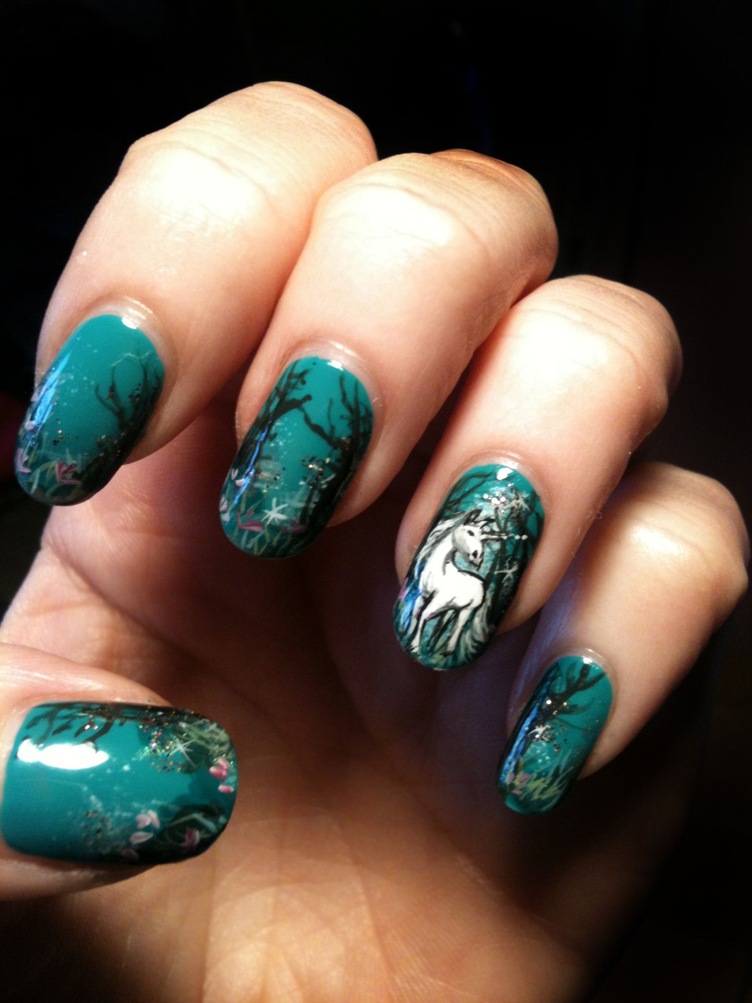 A white Unicorn wandering in an enchanted forest. Nail art by me ...
