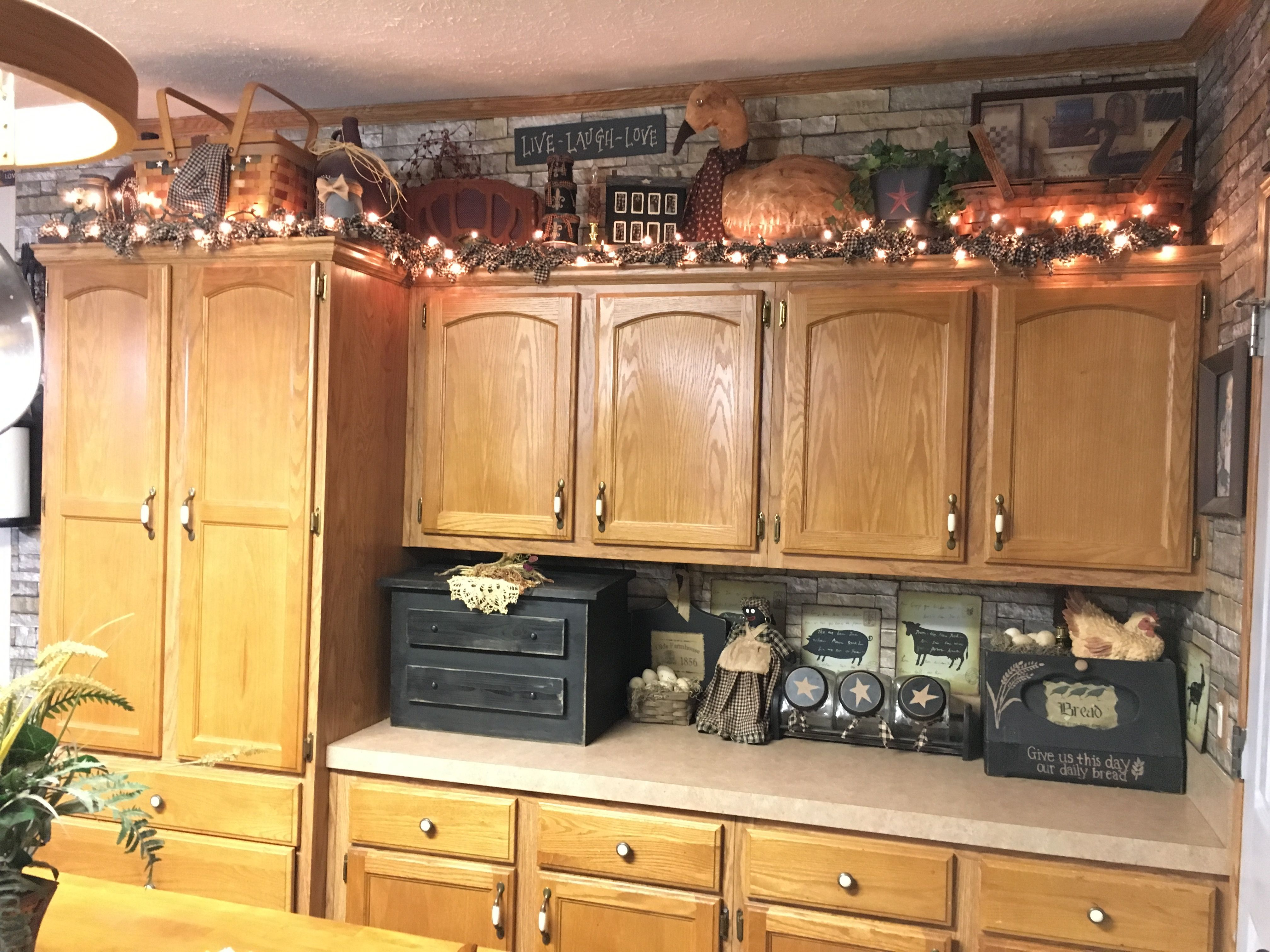 Primitive Kitchen Decor And Above Cabinets Decor In 2020 Primitive Kitchen Decor Kitchen Cabinets Decor Rustic Kitchen