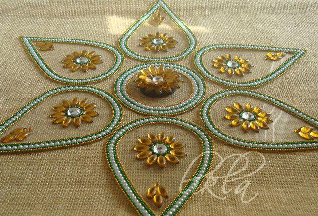 Rangoli art from india diwali decor floor and table for Floor rangoli design