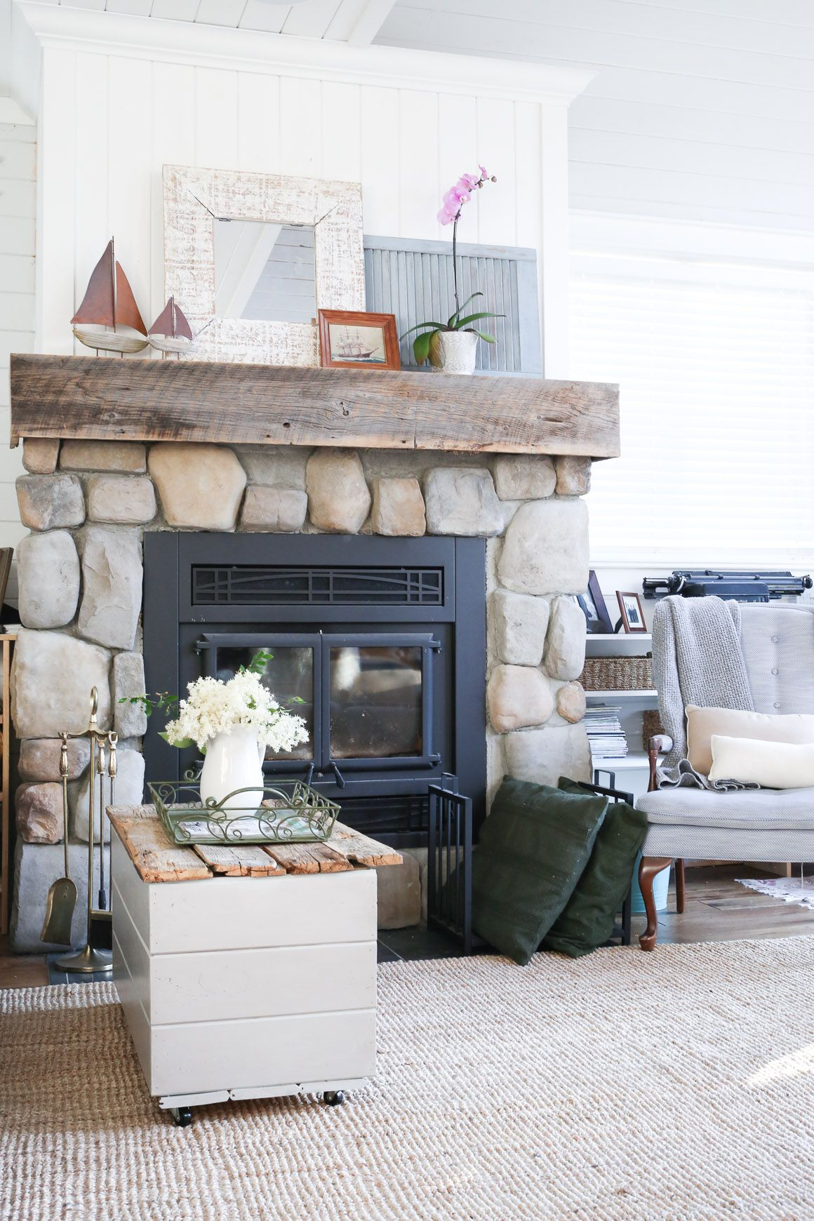Stone Fireplace Construction With Vertical Shiplap Over Mantle Coastal Living Rooms Farm House Living Room Home Fireplace