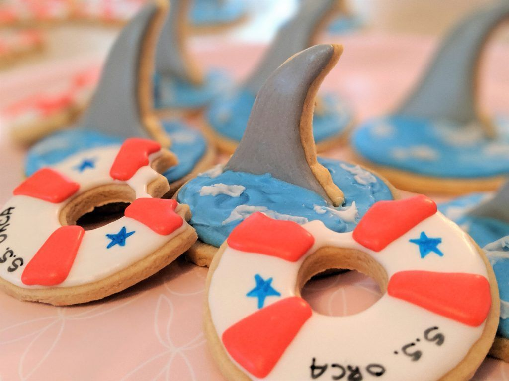 Try making these Shark Week inspired sugar cookies today! The easy tutorial will help any baker create a sharky masterpiece in no time! #sharkweekfood Try making these Shark Week inspired sugar cookies today! The easy tutorial will help any baker create a sharky masterpiece in no time! #sharkweekfood