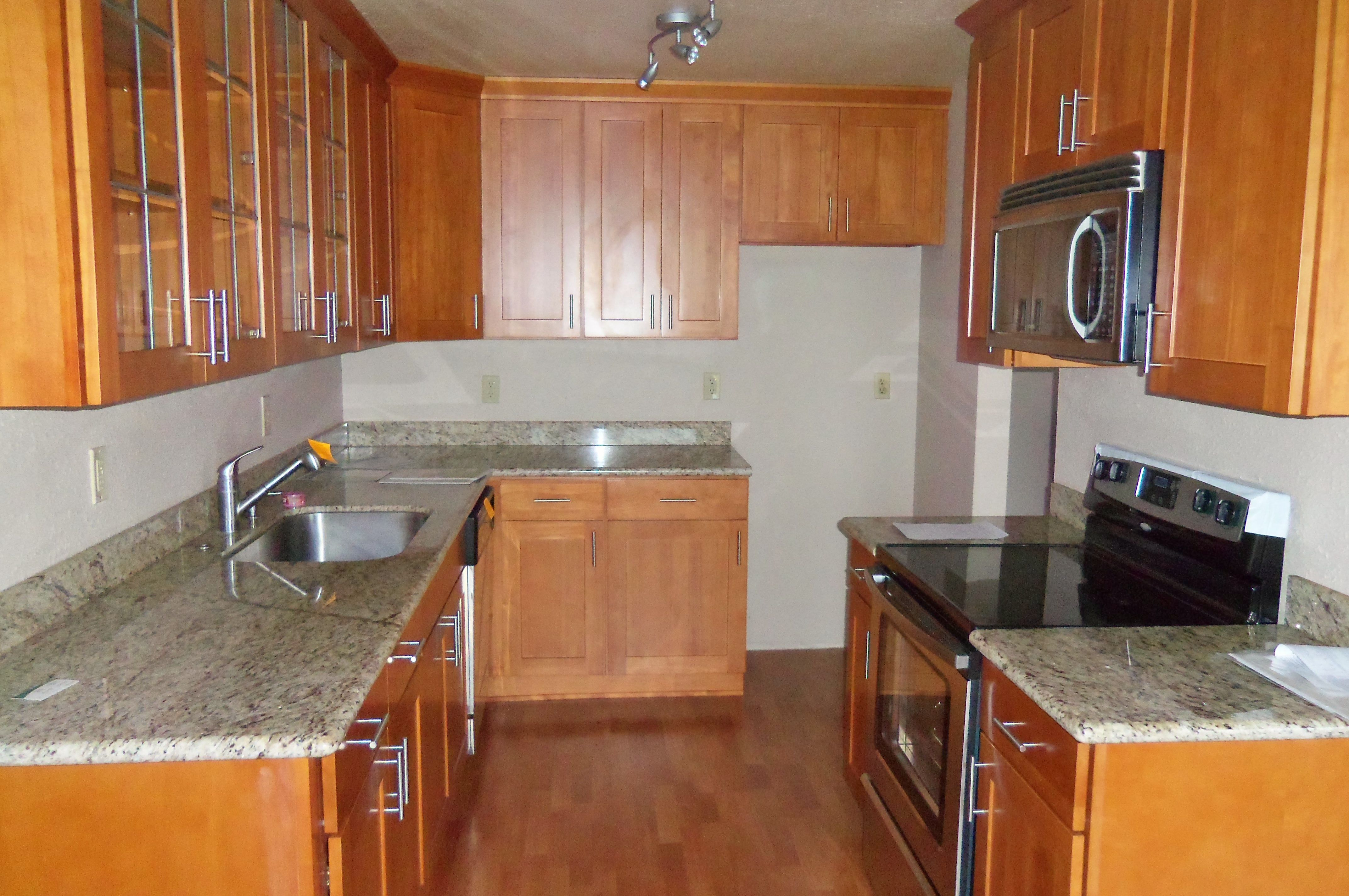 Beautiful Kitchen With Granite Countertops In A Condo On Redondo Beach.  This Bank Owned