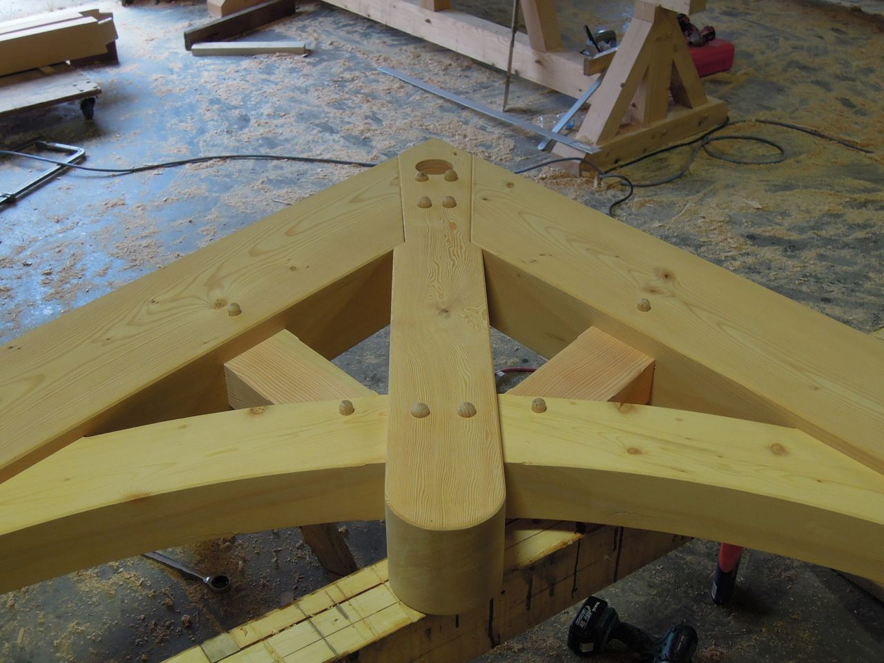 This curve member on truss is cut our from large dimension timber, for small truss it works.