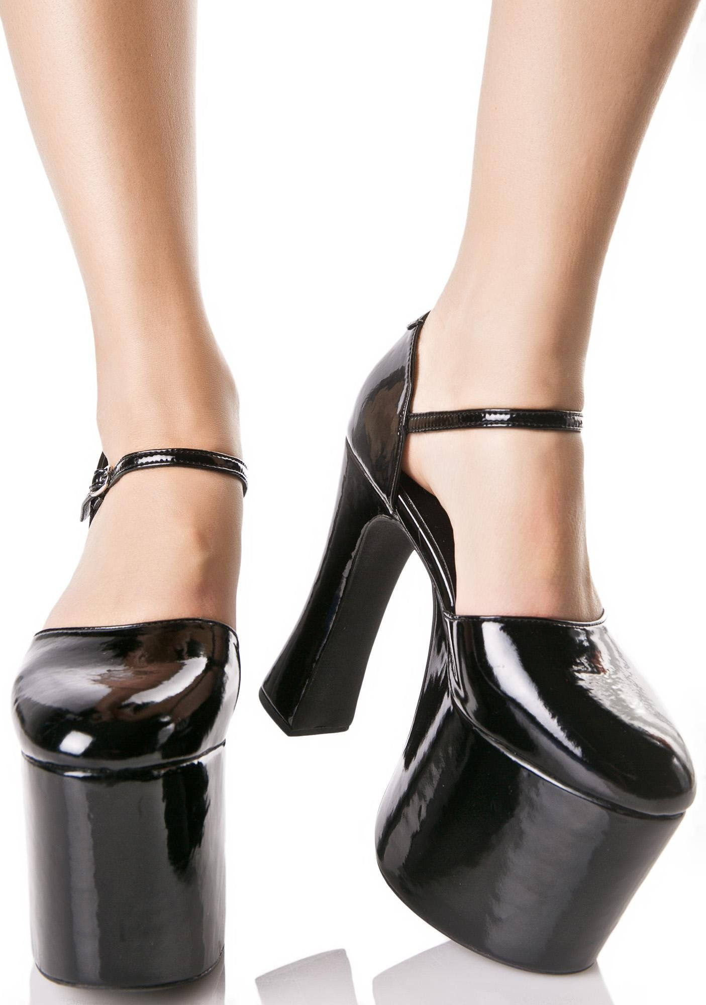 Current Mood Dita Platforms are gonna put on a seductive show. Get a front row view in these stunning platforms that feature a glossy patent construction with rounded toes, open sides, extreme platforms and a buckle ankle strap closure.