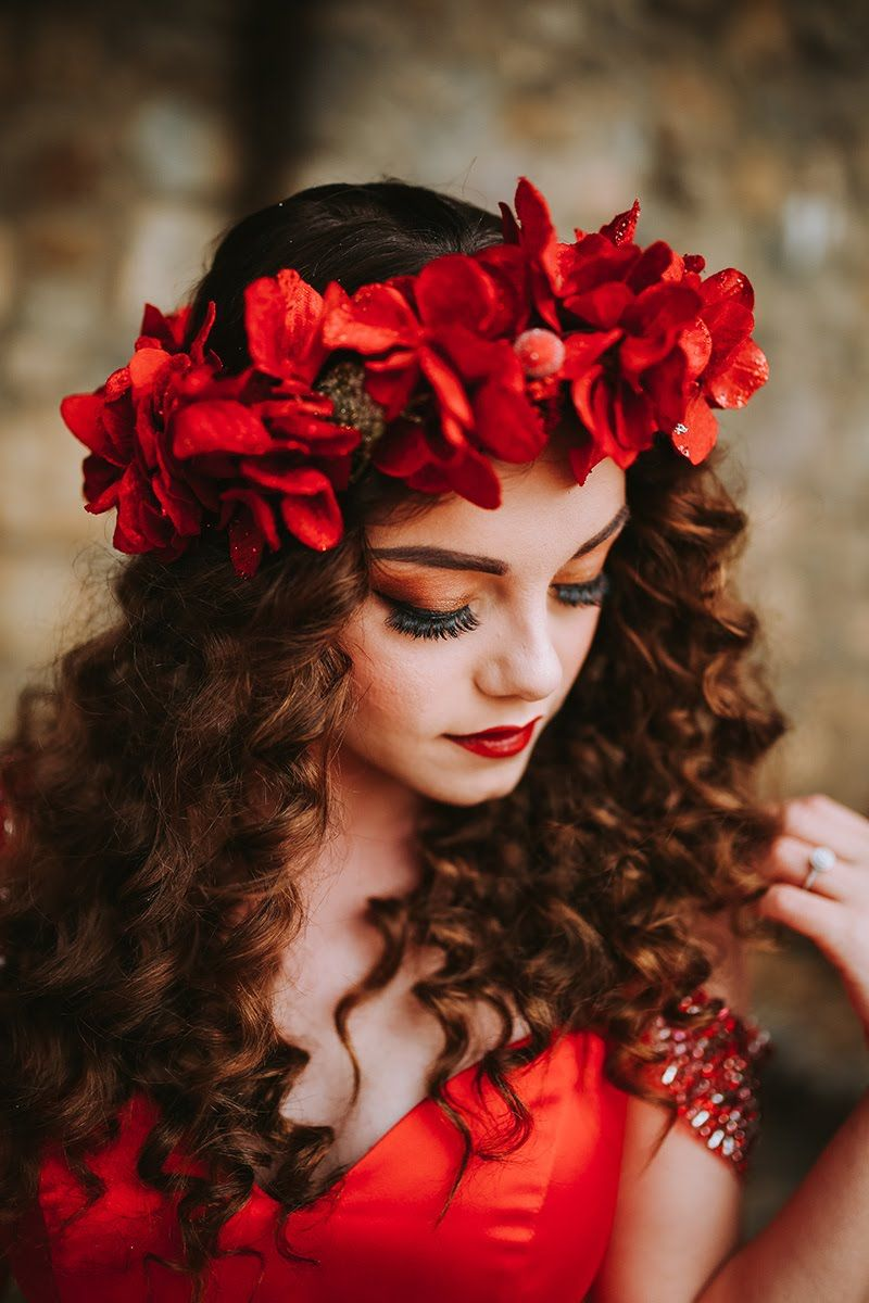 Red Sherri Hill Ballgown With Red Flower Crown On Curly