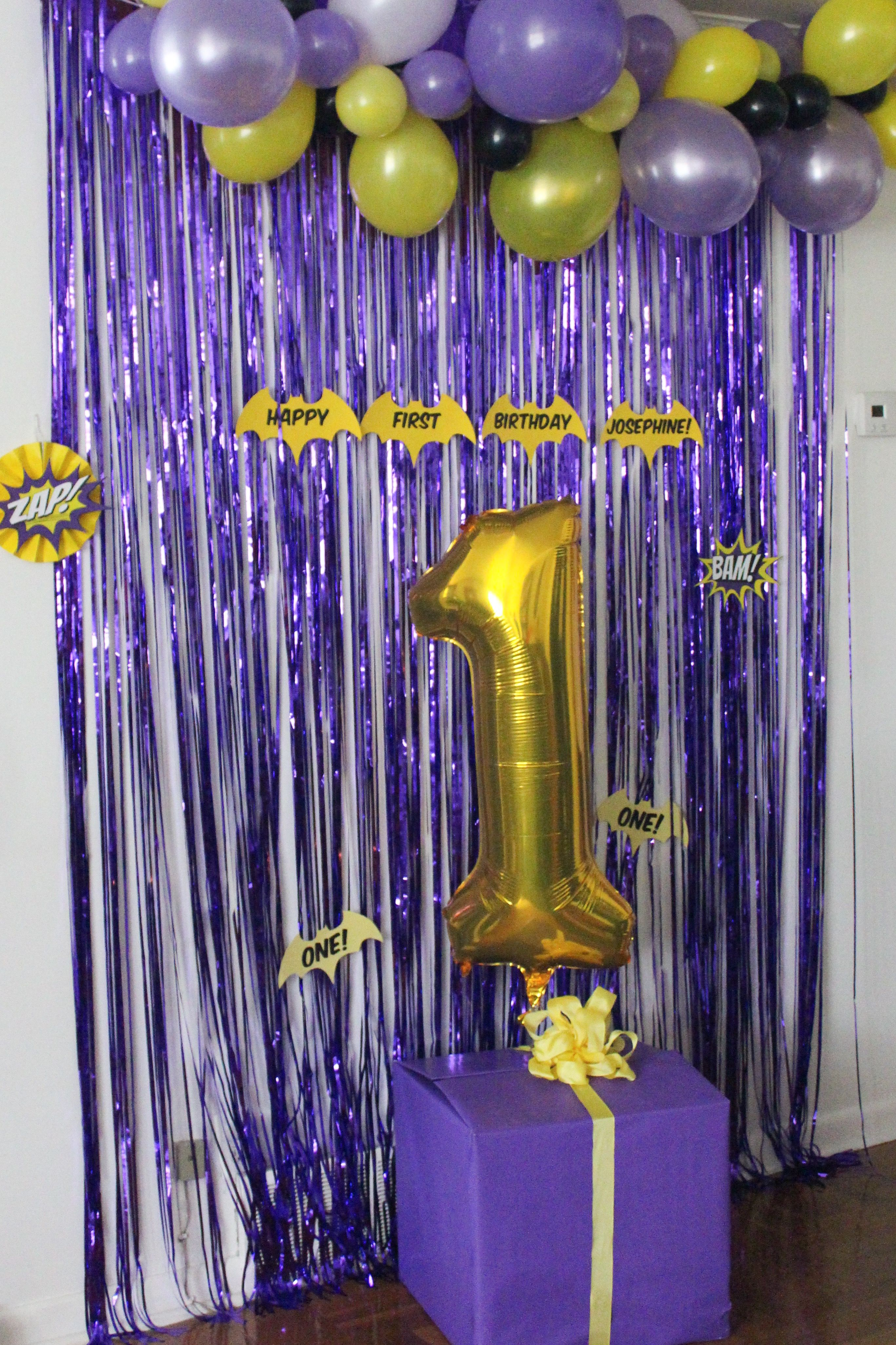 I used fringe curtains from Party City, a balloon strip