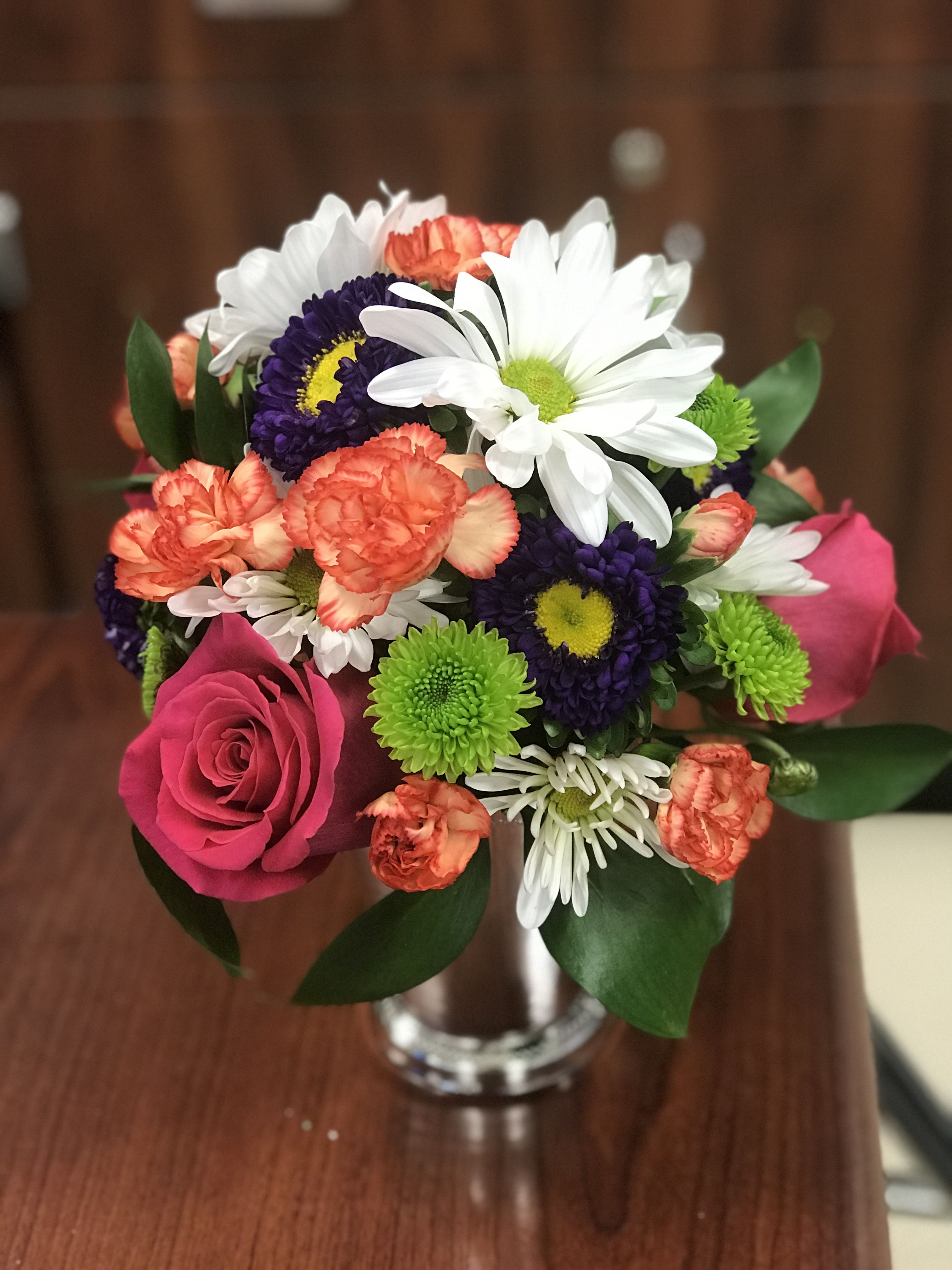 Final Spring Round Design Arrangement Using Purple Chinese Asters Orange Pixie Carnations White Daisy Mums Floral Design Classes Floral Foam Hot Pink Roses