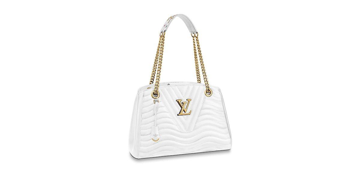 LOUIS VUITTON Site Officiel France - Cabas Louis Vuitton New Wave Chain LV  Cuir New Wave Découvrez la collection de Sacs à main de luxe et profitez de  la ... 6fbafc6a751