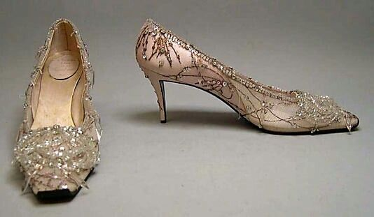 Evening shoes House of Dior (French, founded 1947)  Designer: Roger Vivier (French, 1913–1998)  Date: 1960  Culture: French  Medium: silk, nylon, leather, glass, metallic thread  Dimensions: Length: 9 1/4 in. (23.5 cm) Height (of heel): 2 1/2 in. (6.4 cm)  Credit Line: Gift of Valerian Stux-Rybar, 1979