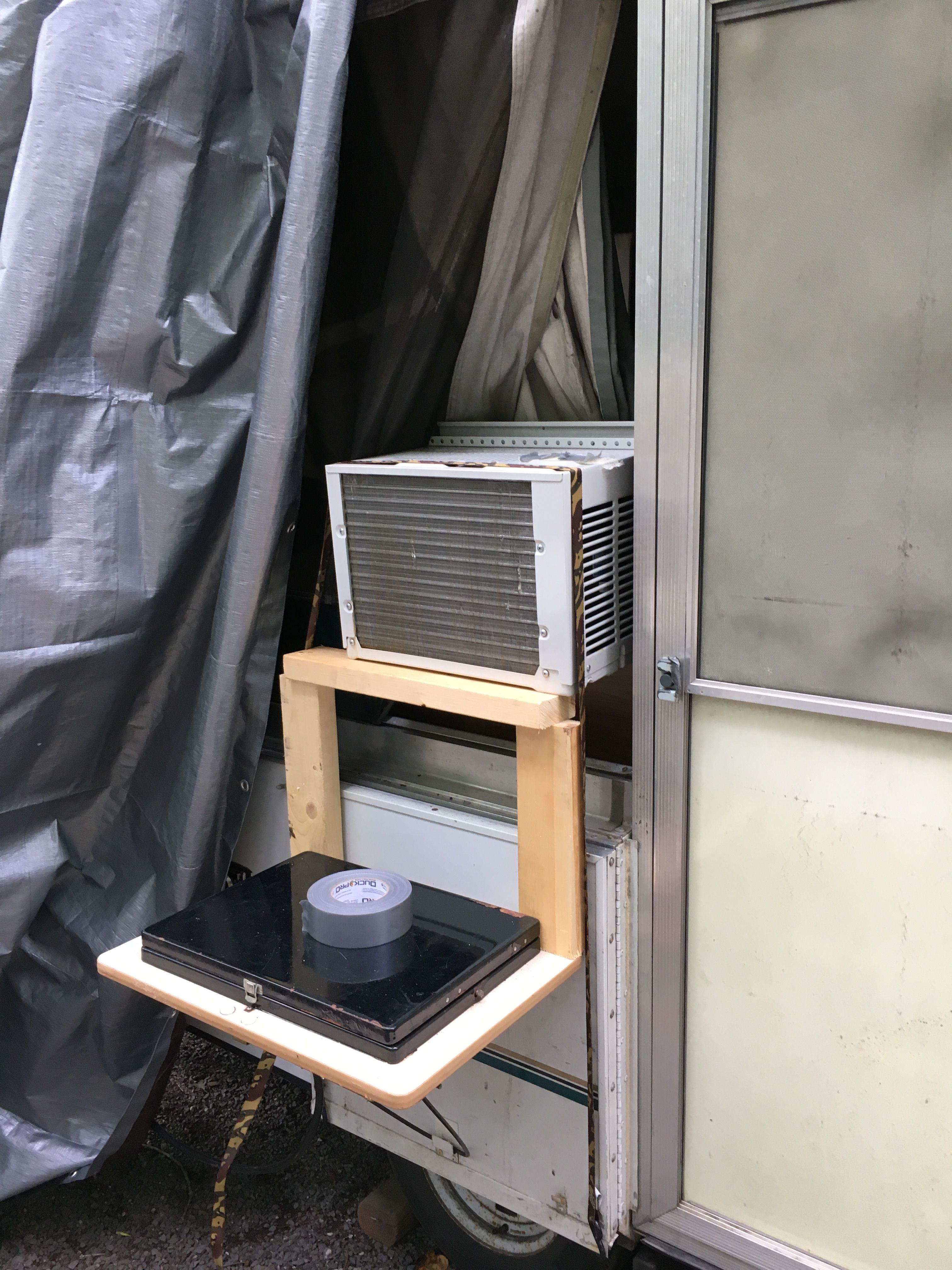 Window air conditioner in Coleman camper Pop up camper