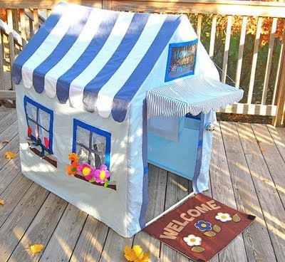 I'm a sucker for a cute playhouse!  This one is SO sweet!