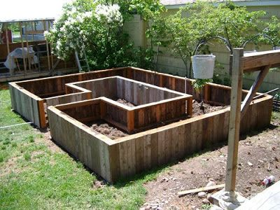 Raised bed design raised garden or flower bed walk into for Garden sectioning ideas