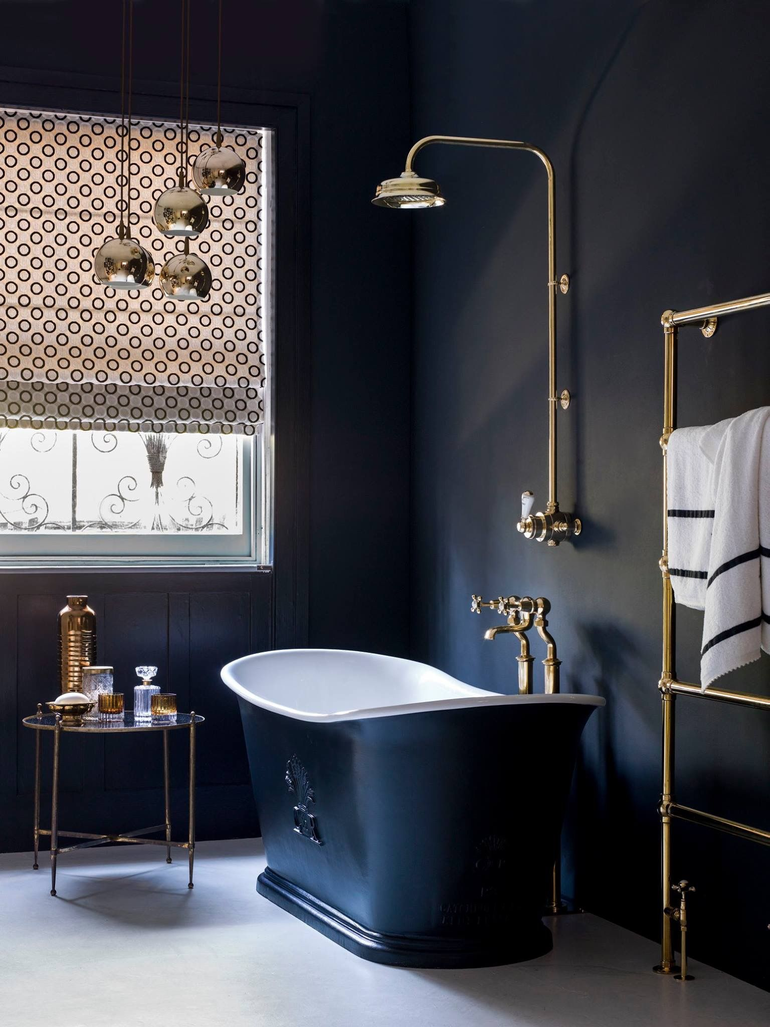 A Dark Bathroom Decor With Shower Over A Free Standing