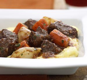 Beef roast is flavored in a red wine sauce for this traditional French stew recipe. Use the slow cooker directions when you need a hearty, table-ready meal on busy nights.