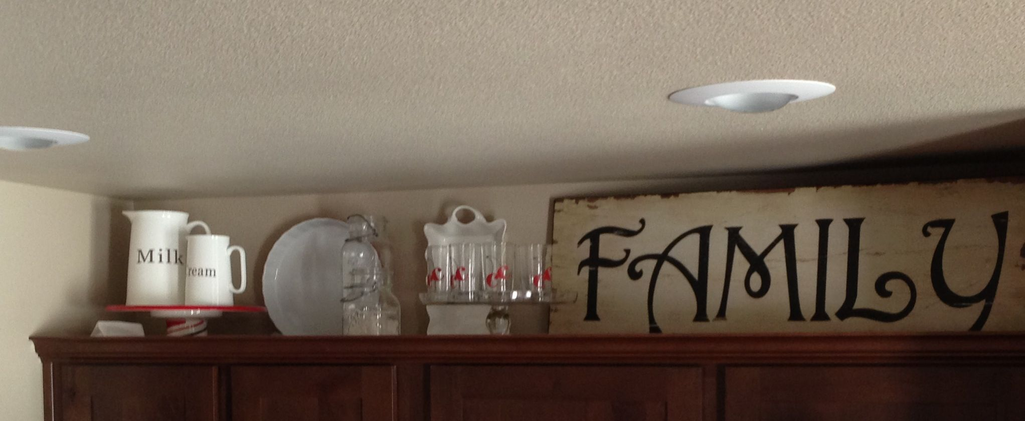 Above my cabinets decor. C glass from Crate and Barrel. Family sign from Hobby Lobby.