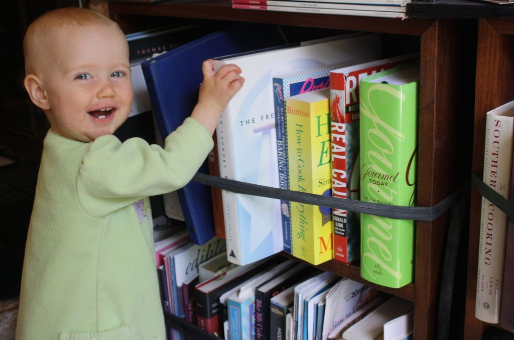use old bike tubes on bookshelves to baby proof them more - Child Proof Bookshelves