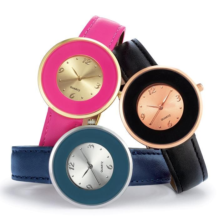 Round Faced Strap Watch With Wide Bezel. The Color Of The