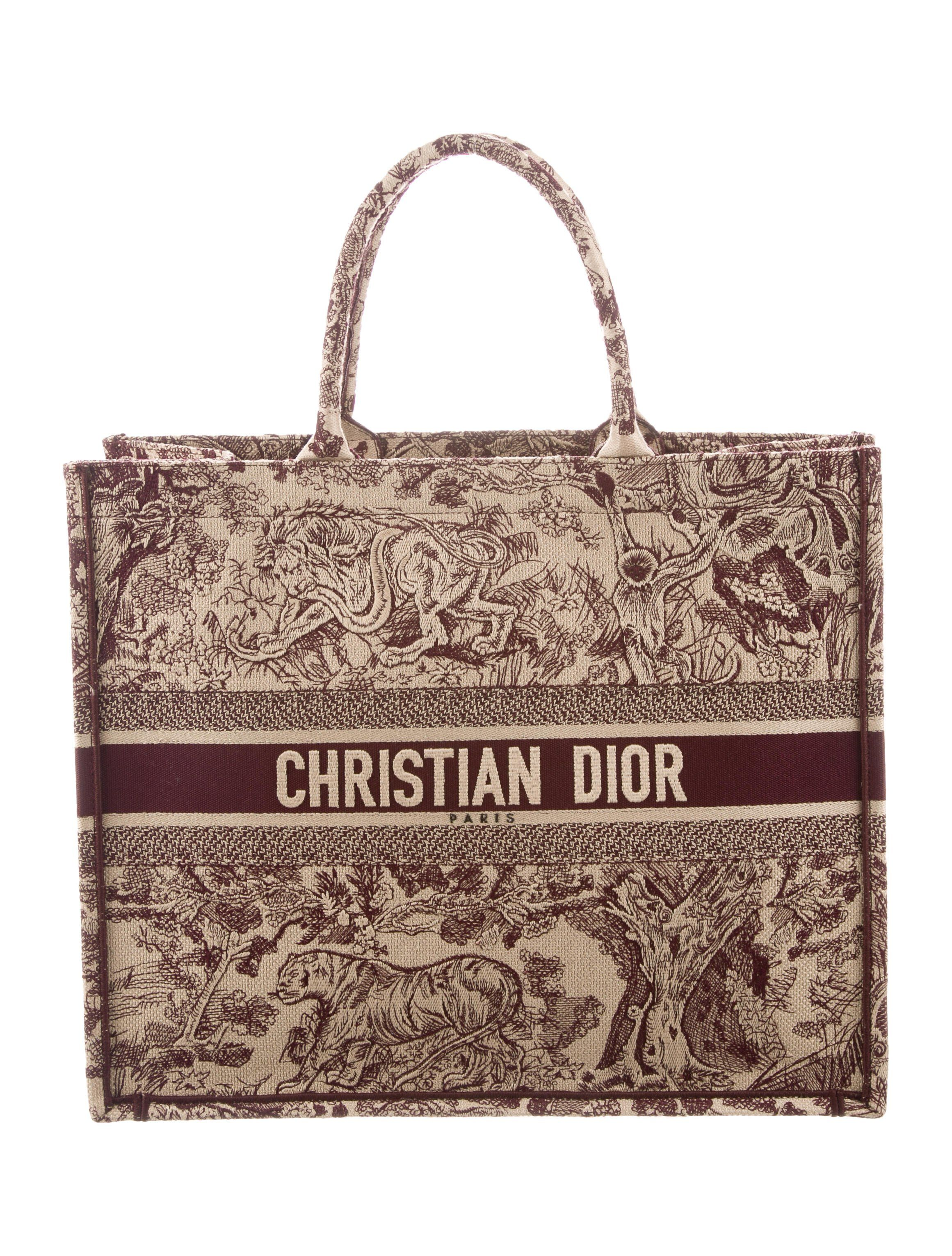 From the 2019 Cruise Collection. Maroon and creme embroidered canvas Christian  Dior Book Tote with 47436e75c064b