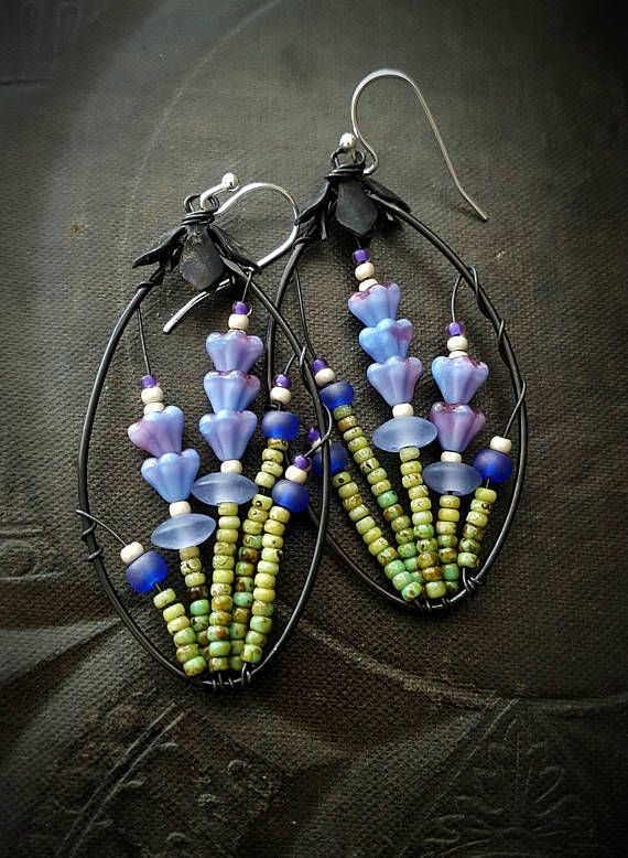 100 % Artisan Made; wire wrapped glass flowers and green stems that form sweet~ sweet lavender, finished off with sterling silver ear wires • very light weight!!!!!!!!!!!!!! • never to be duplicated exactly • totally unique • 100% ARTISAN HANDMADE!! • Yucca Bloom original ◄The, Blossom Series, is EXCLUSIVE TO/AND ORIGINAL WORKS OF YUCCA BLOOM FINE ARTISAN JEWELRY►