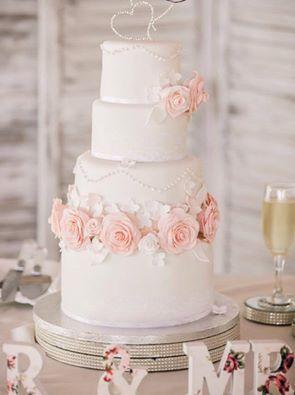 Vanilla Sponge Wedding Cake With Raspberry And Ercream Filling Decorated Handmade Sugar Flowers