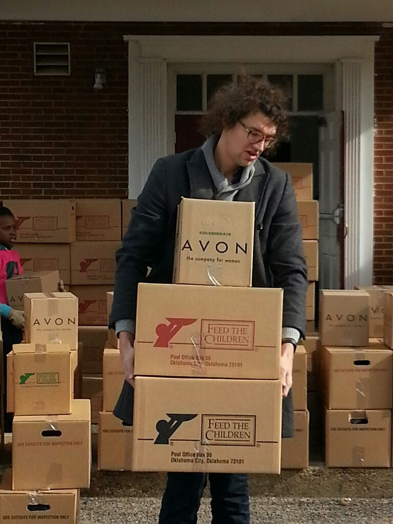 Luke from for KING & COUNTRY distributes food to those in