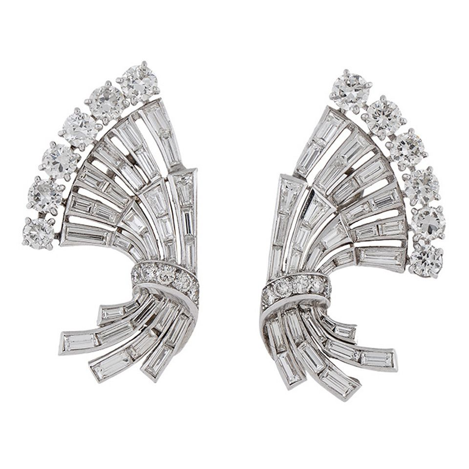 A Pair of Diamond Platinum Spray Earclips | From a unique collection of vintage clip-on earrings at https://www.1stdibs.com/jewelry/earrings/clip-on-earrings/