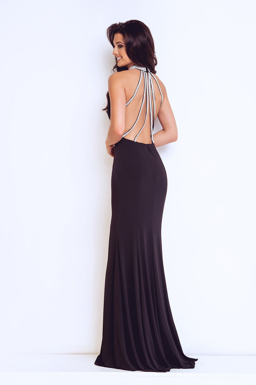 Backless back detailed dress. This Halterneck backless gown comes in ...