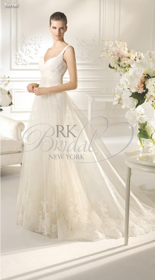 RK Bridal in NYC: White One Spring 2013 - Nerveo  A division of Pronovias. Tulle with rebrode lace application gown with v-neckline. Shown with tulle with lace application veil style V-3318, sold separately.
