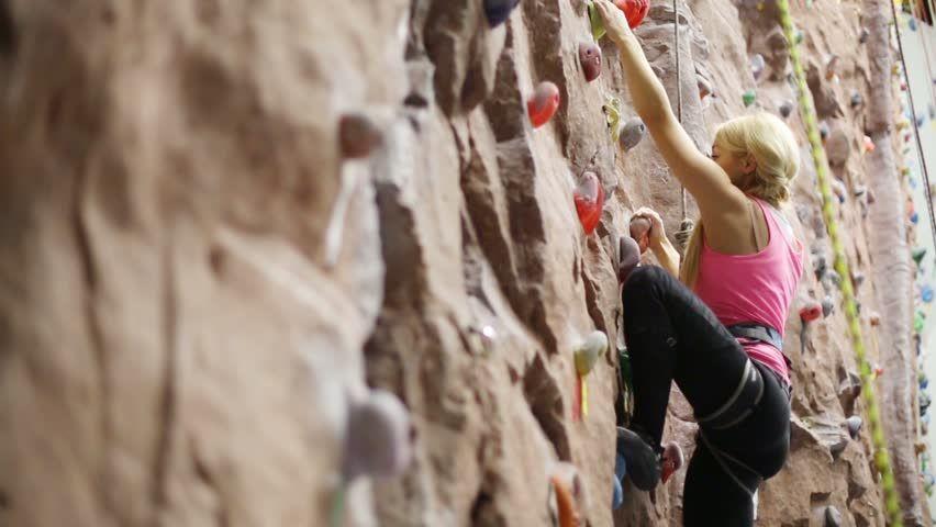 Blonde female rock climber