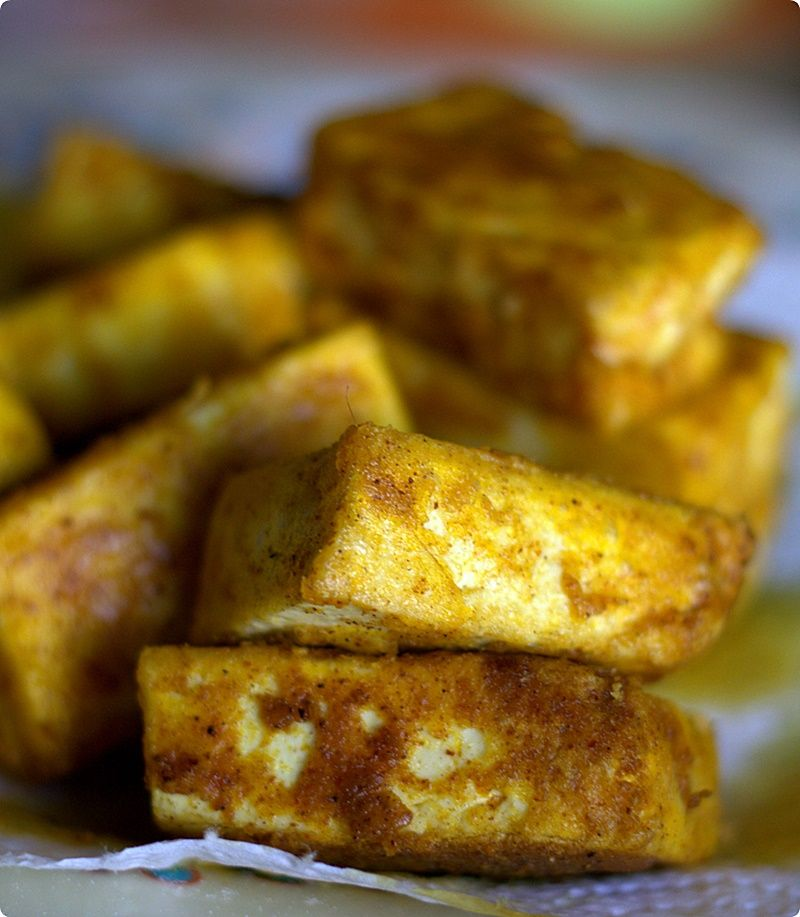 Crispy fried tofu. Crispiness from rice flour and the color from red palm oil