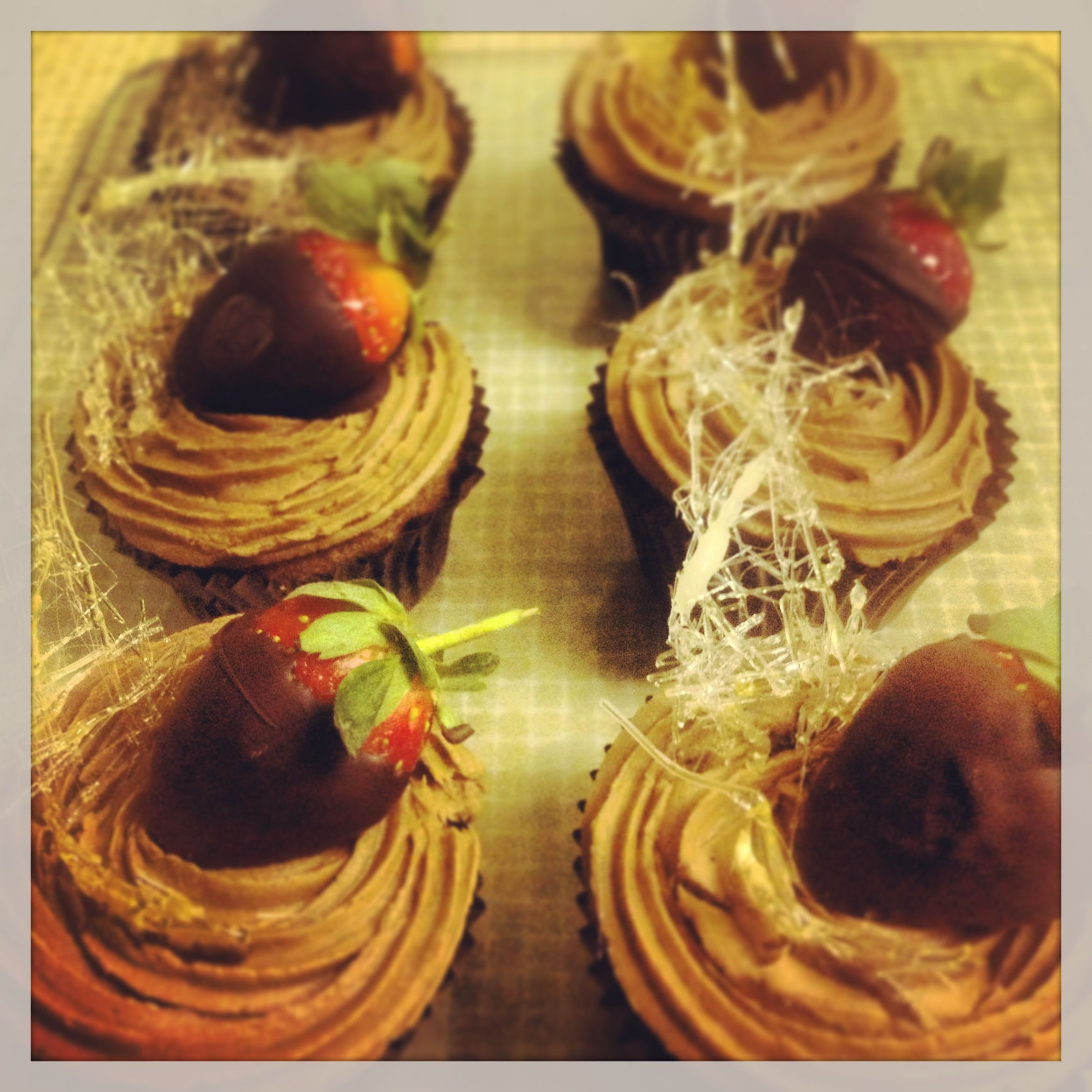 I made these chocolate cupcakes with spun sugar to