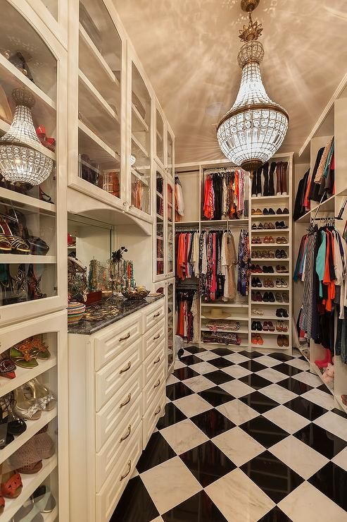 Amazing walk-in closet features a Restoration Hardware 19th C. French  Empire Crystal Chandelier