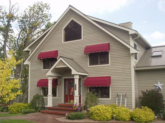 Tan House With Awnings
