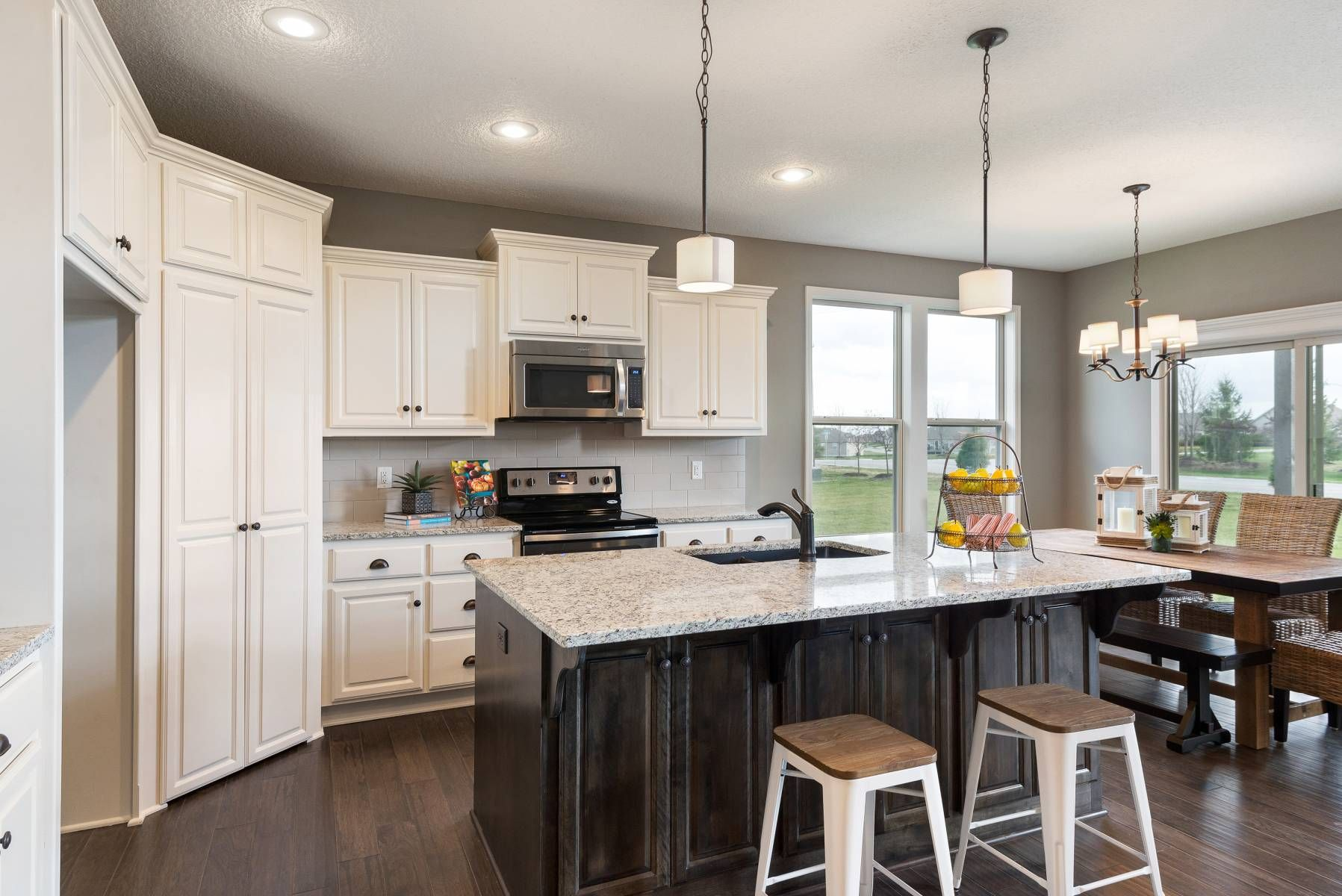 White Kitchen Cabinets And A Large Island In The Bayfield Floor