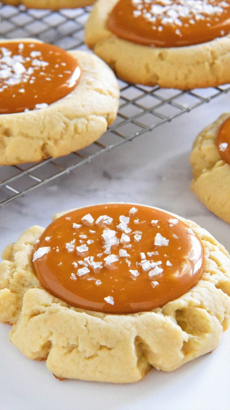 These easy Salted Caramel Cookies start with giant bakery style soft sugar cookies filled with tons of chewy salted caramel and topped with flaked sea salt