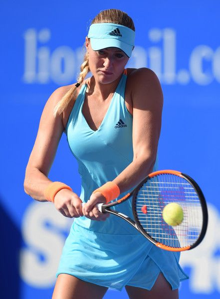 French tennis player Kristina Mladenovic returns the ball ...