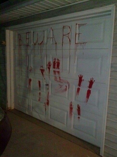 Red hand paint makes an easy,fun ,n creepy Halloween decoration - creepy halloween decor