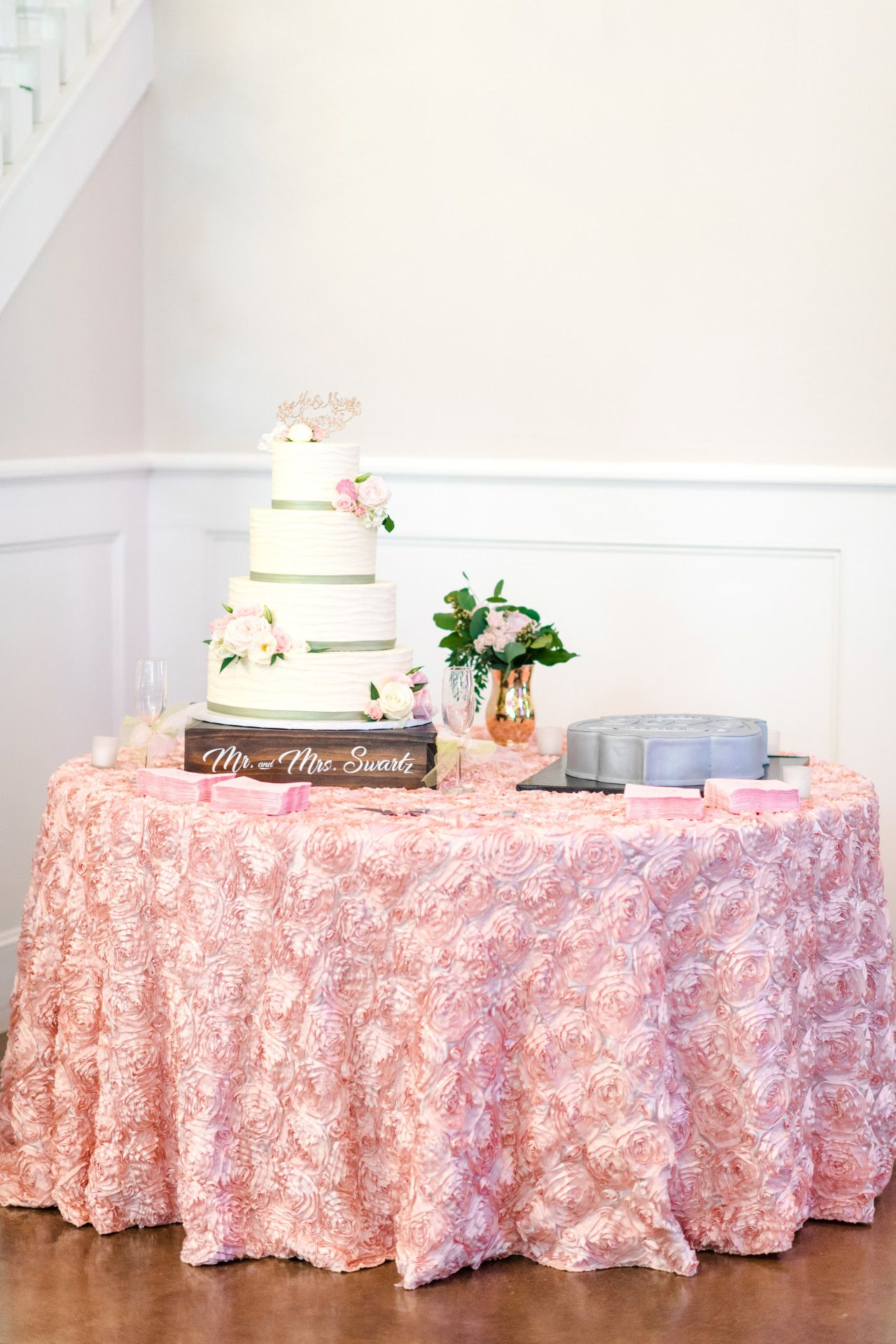 Wedding cake table decoration ideas  rose petal pink wedding linen  modern rustic wedding cake table
