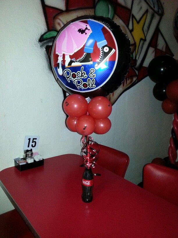S theme balloon centerpiece using a coca cola glass