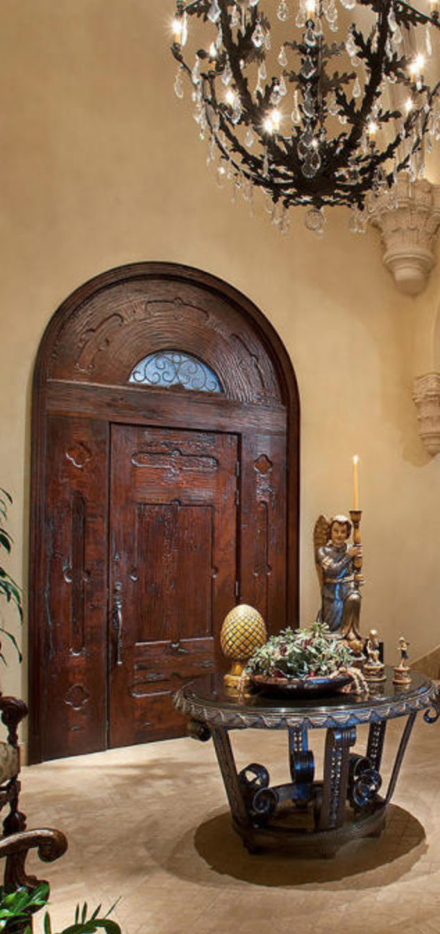 hand carved arch door in Old  World simple style ideal for fine Lodge or Hacienda styles. Custom draperies, bedding, home accents online DesignNashville