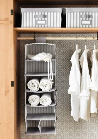 Grey And White Storage Boxes Inside A Wardrobe Underneath Is A