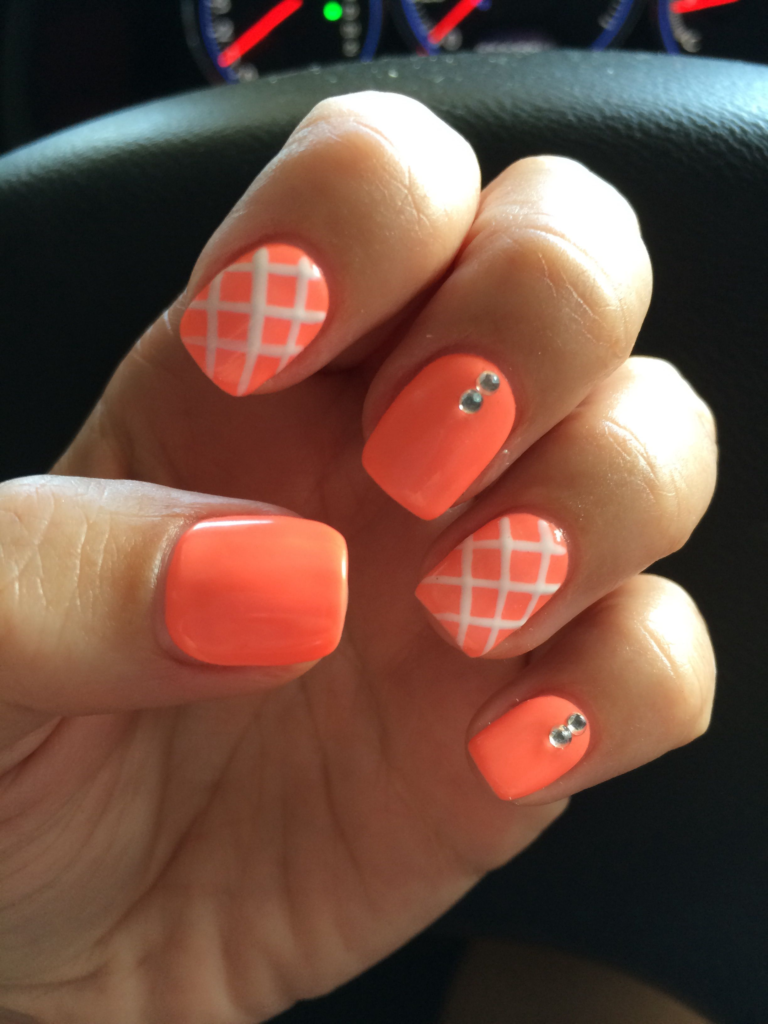 Summer orange gel manicure with white stripes and crystal