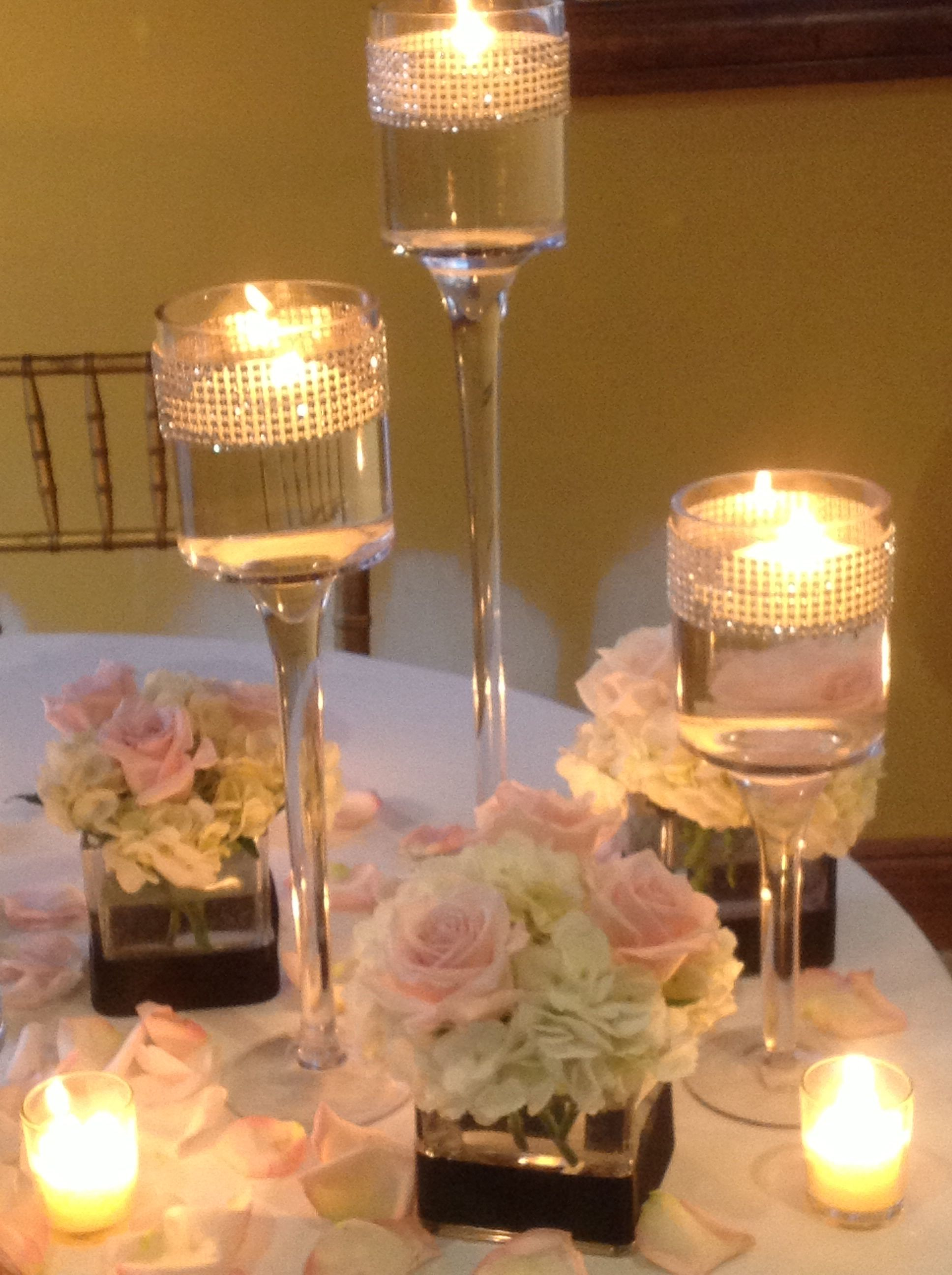 Wedding Centerpiece Of Cube Trio White Hydrangea And Pink Roses With 3 Pedestals Floating Candles Pall Surrounded By Rose Petals Votive
