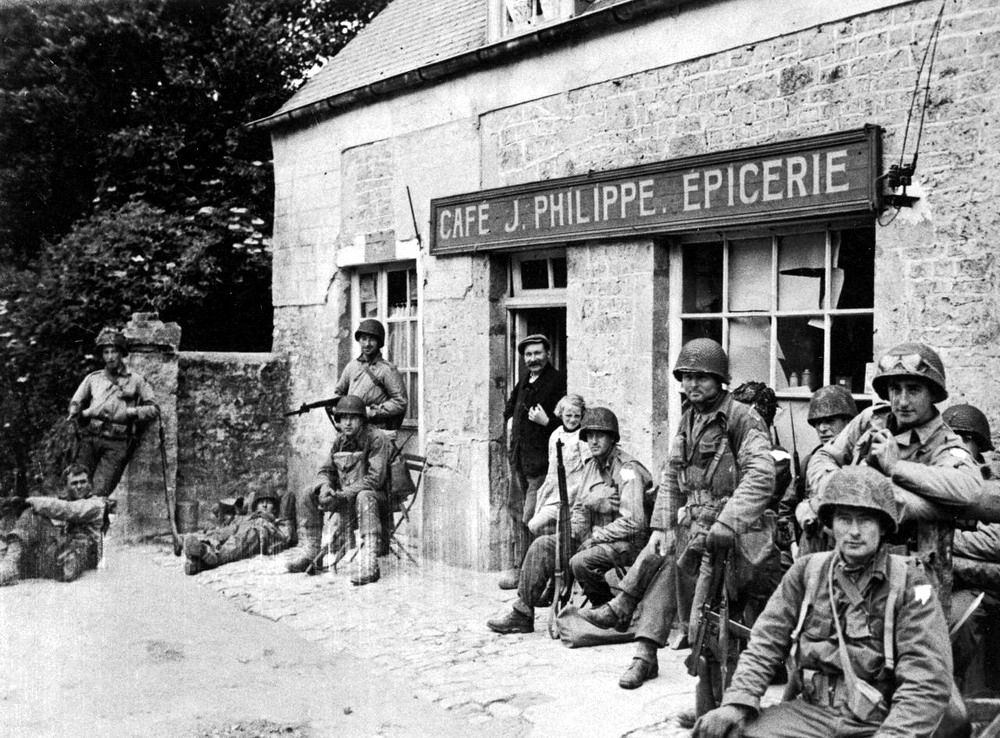American paratroopers in Sainte-Mère-Église. Founded in 1080, it's believed to have been the first town liberated by the Allies during D-Day. Though a small village, it was located in a strategic route. Anticipating that the Germans would use that route in a counter-attack, the Allied command ordered a major attack by the 82nd and 101st airborne divisions on June 6. Paratroopers started landing at 1:40 AM, suffering severe casualties, but finally defeating the German garrison at 5:00 AM.