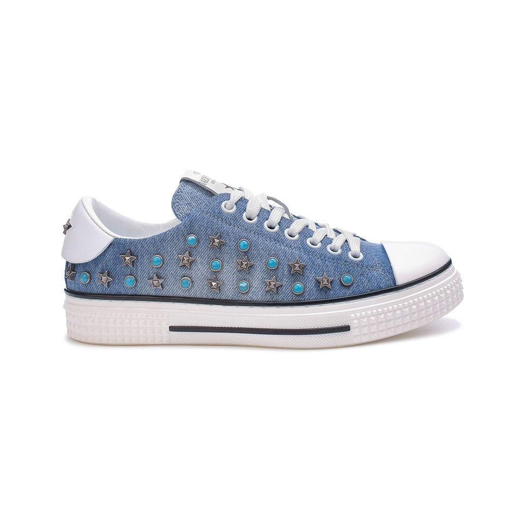 An undeniable goop HQ favorite, this denim sneaker is adorned on both sides with antiqued silver and turquoise studs.