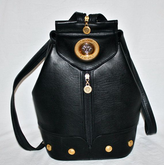 45856bac8b THIS ITEM IS GUARANTEED AUTHENTIC backed with a FULL REFUND. Gorgeous  Versace bag with medusa