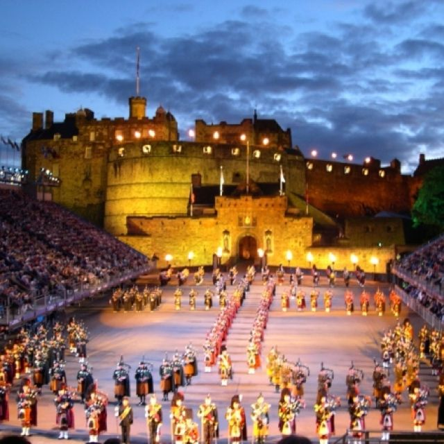 The Military Tattoo, Edinburg, Scotland  Worst weather of our two weeks that night but still awesome!  Lone piper ...so stirring.  Takes me back to my days as a majorette/drum corp:)